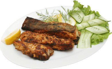 Grilled Fish Fillet with on BBQ with vegetables