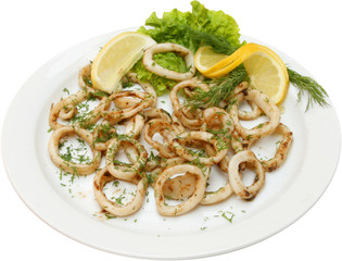Fish salad with squid rings and testy herbs