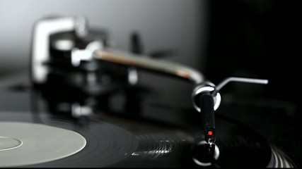 Dj needle on spinning record