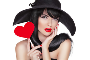 Glamour Fashion Brunette Woman Portrait holding red heart in bla
