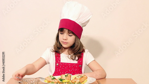 little girl cook eat salmon seafood