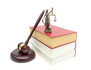 books, gavel and justice statue isolated on white background
