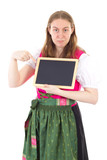 Youngster in dirndl pointing to board poster