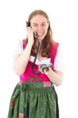 Bavarian maid dialling her friend