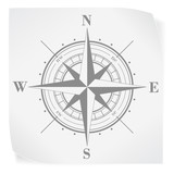 Compass rose over white paper sticker isolated on white