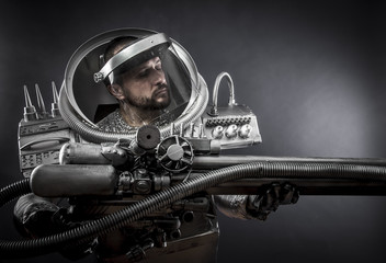 Cosmos, Astronaut on a black background with huge weapon.