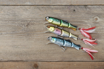 colorful lures on the wooden pier