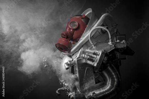 Astronaut with gas mask on a black background with huge weapon.