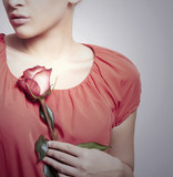 Girl and Flower.Red Rose on Red Dress.Tender Beauty.Lovely Gift