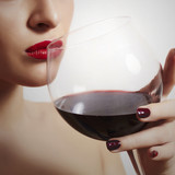 Woman Drinking Red Wine.Red Lips.Tasty Dry Wine.Manicure