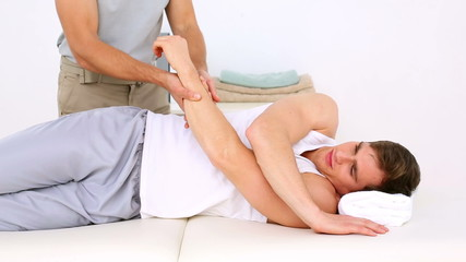 Physiotherapist moving patients injured wrist