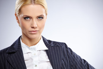 Close up shot of smiling young businesswoman isolated