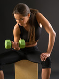 Woman doing seated dumbbell curl