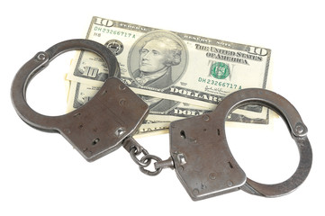 Handcuffs and money isolated on white background