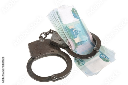 Handcuffs and money on white background