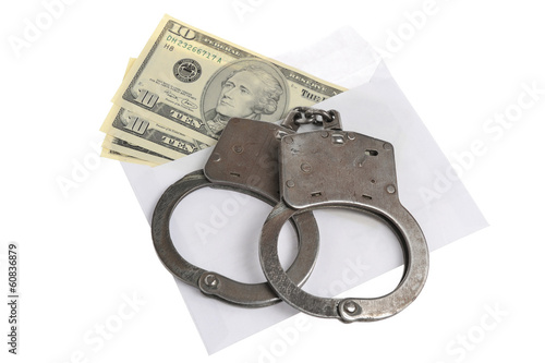 Handcuffs and white envelope with money on white background