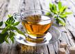 Transparent cup of green tea