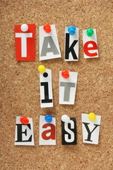 The phrase Take It Easy on a cork notice board