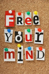 The phrase Free Your Mind on a cork notice board