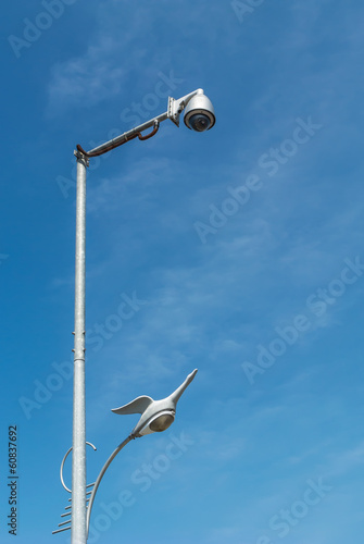 security camera and swan light on blue isolated
