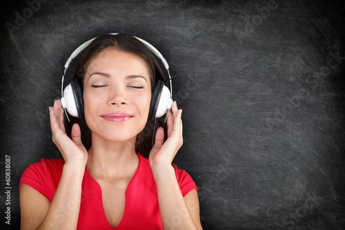 Music in headphones - Beautiful woman listening