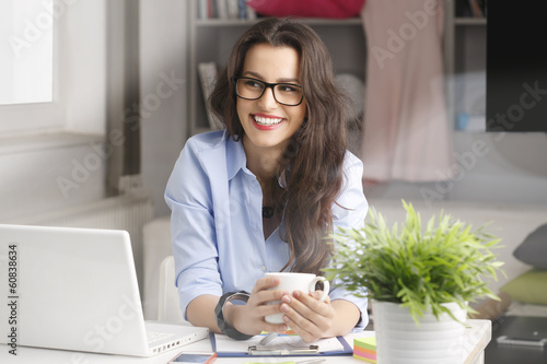 Young fashion designer working at home