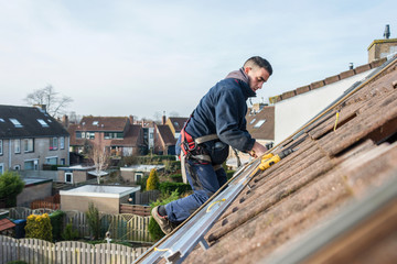 man making the construction for the solar panels