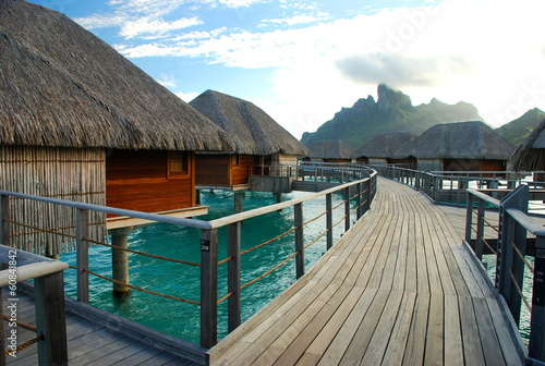 Overwater bungalows in a tropical resort. Bora Bora, Polynesia