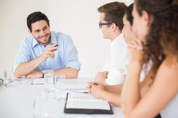 Smiling businessman in meeting