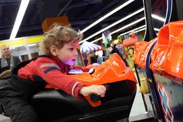 Child driving motorbike toy