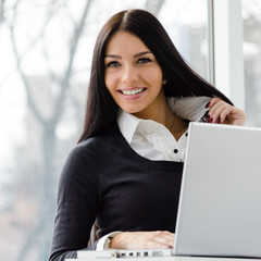 young business woman using laptop PC at office