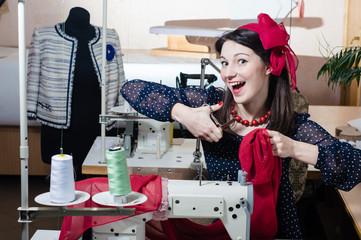Funny young pinup woman with sewing machine