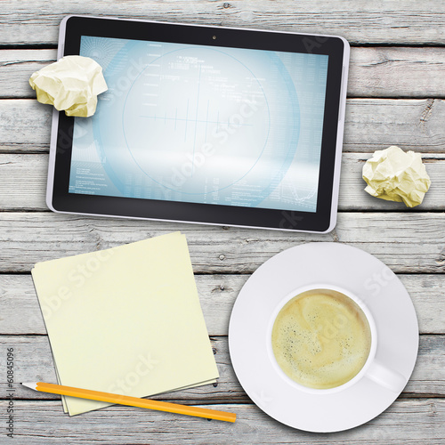 Tablet pc and coffee cup