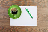green coffee cup on white blank