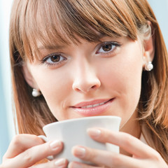 Businesswoman with cup of coffee at office
