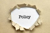 Policy text on paper hole