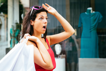 Amazed shopping woman