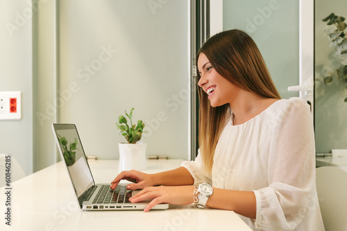 Young Woman Working with a Laptop