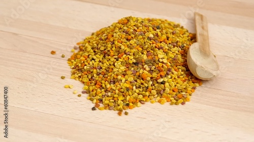 Dried bee pollen spins on the table