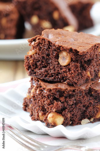 Fresh homemade chocolate brownies with hazelnuts