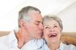 Senior man kissing happy wife