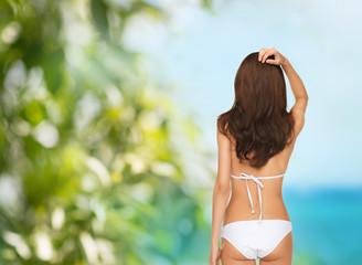beutiful woman posing in white bikini