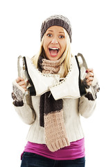 Excited  woman with ice skating, winter sport activity