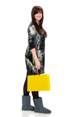 Pretty woman with shopping bag