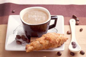 Coffee served with croissant