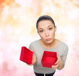disappointed asian woman with empty red gift box