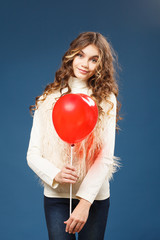 Young cute girl with heart-shaped ballon