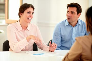 Businesswoman explaining to colleagues an idea