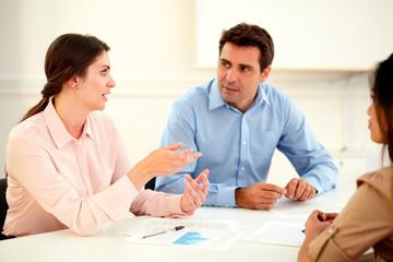 Female executive explaining a idea to colleagues