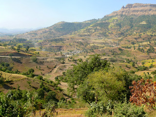 Ethiopian village in the valley of mountains. Africa.